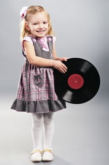 Free The Little Girl Holds Vinyl Record Stock Image - 18434101
