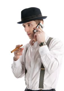 Free Young Man Talks By A Mobile Phone And Holds Cigar. Stock Photography - 18434112