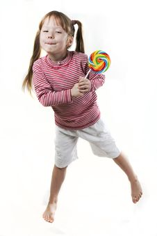 Little Girl Eats A Lollipop Isolated On White Royalty Free Stock Images
