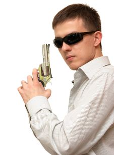 A Guy With A Gun In His Hand Wearing Sunglasses Stock Photography