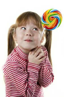 Little Girl Eating A Lollipop Royalty Free Stock Images