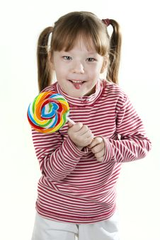 Little Girl With Lollipop And Sticking Out Tongue Royalty Free Stock Images
