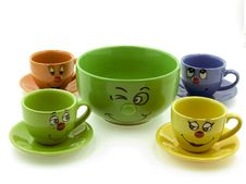 Free Four Kid S Cups Beside A Green Bowl Royalty Free Stock Photography - 18434907
