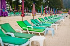 Free Empty Chaise Lounges On A Beach Royalty Free Stock Image - 18435236