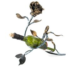 Free Metal Rose And A Bottle Of Wine Stock Images - 18435624
