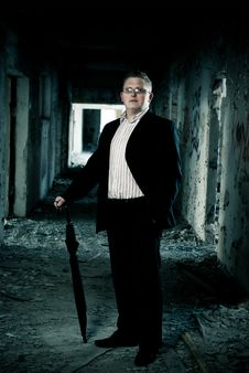 Man In Suit With Cane In Ruin House Stock Images