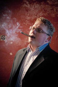 Smoking Man In Black Suit Stock Image