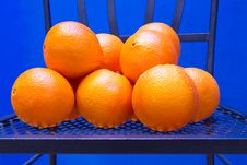 Fresh Oranges On A Chair Royalty Free Stock Images