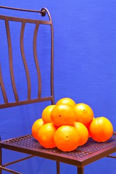 Free Fresh Oranges On An Iron Chair Stock Photo - 18439870