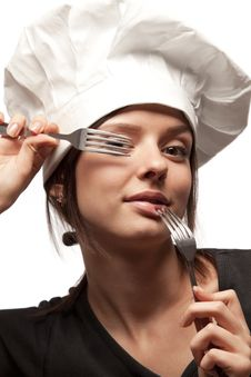 Female Chef Looking Through Forks Stock Photos