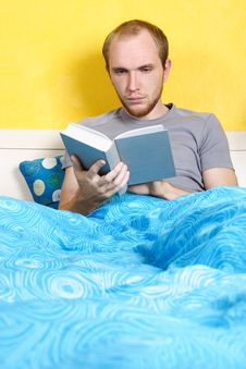 Free Man Lying In Bed And Reading Book Stock Images - 18442594