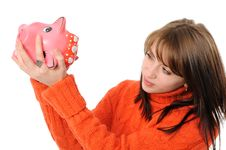 Young Woman Standing With Piggy Bank Royalty Free Stock Photo