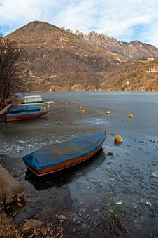 Boat In An Icy Lake Royalty Free Stock Photo