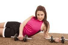Woman Lay Weights Royalty Free Stock Photo