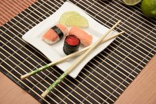 Free Japanese Sushi With Chopsticks On Bamboo Mat Royalty Free Stock Images - 18447049