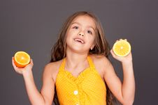 Free Cute Young Girl With Oranges Royalty Free Stock Images - 18447099