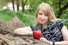 Free Beautiful Smiling Young Woman With Red Apple In He Stock Photography - 18447112