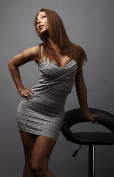 Beautiful Girl Pose Near Stylish Armchair. Photo.