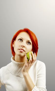 The Girl With An Apple In A Hand Stock Image