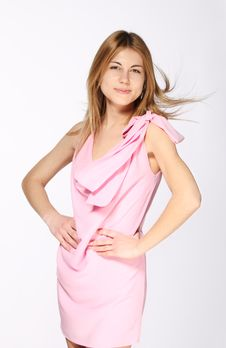 Free Smiling Blond Girl In The Pink Dress Stock Photography - 18448212