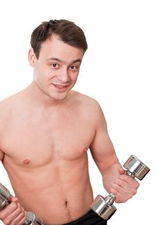 Young Man With Naked Torso With Dumbbells Stock Photo