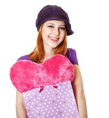 Beautiful Red-haired Girl With Heart In Bag. Stock Image