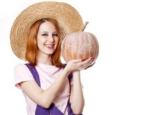 Free Young Girl In Overalls With Pumpkin. Royalty Free Stock Image - 18449516
