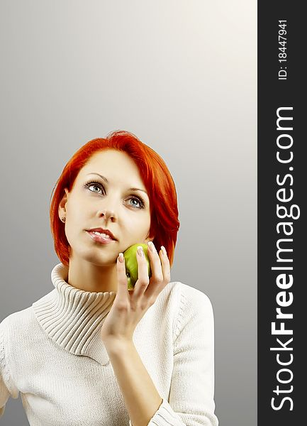 The girl with an apple in a hand