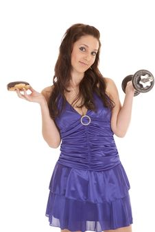 Free Woman Blue Dress Weights Donut Smirk Stock Photos - 18453283