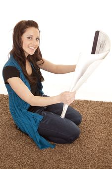 Free Woman On Carpet Looking At Plans Stock Images - 18453654