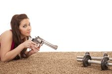 Woman Pointing Gun At Weights Serious Royalty Free Stock Images
