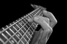 Fingers On Guitar Fretboard Stock Photography
