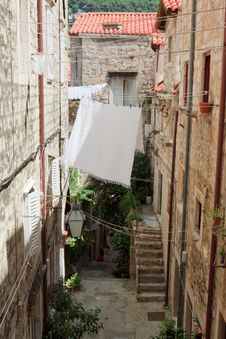 Alley With Laundry Stock Images