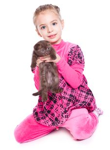 A Smiling Girl Is Playing With A Kitten Royalty Free Stock Photo