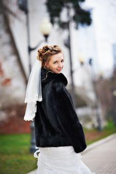 Happy Bride In Autumn Park Stock Photo