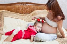 Free A Girl Listens To The Mother S Abdomen Royalty Free Stock Photo - 18458165