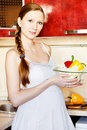 Free Pregnant Woman In Kitchen Making A Salad Stock Photography - 18468692
