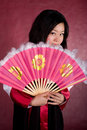 Free Asian Woman In Traditional Dress With The Fan Royalty Free Stock Photography - 18469227