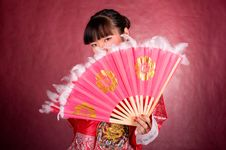 Asian Woman In Traditional Dress With The Fan Royalty Free Stock Photo