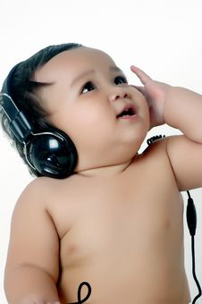 Free A Chubby Little Girl Listen To Music With Headphon Royalty Free Stock Image - 18472326