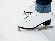 Free Woman Legs In White Ice Skates Stock Images - 18472734