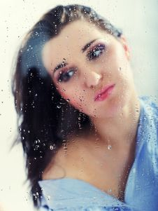 Free Pretty Lonely Girl Looking To Rainy Window Stock Photography - 18474412