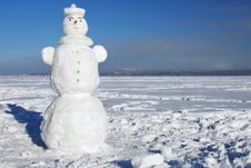 Snowman On A Wintry Sunny Day Royalty Free Stock Photography