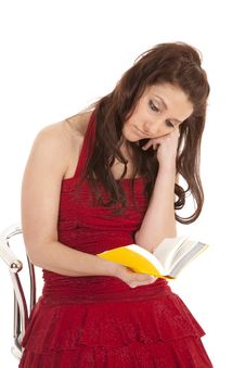 Woman Red Dress Bored Reading Stock Image