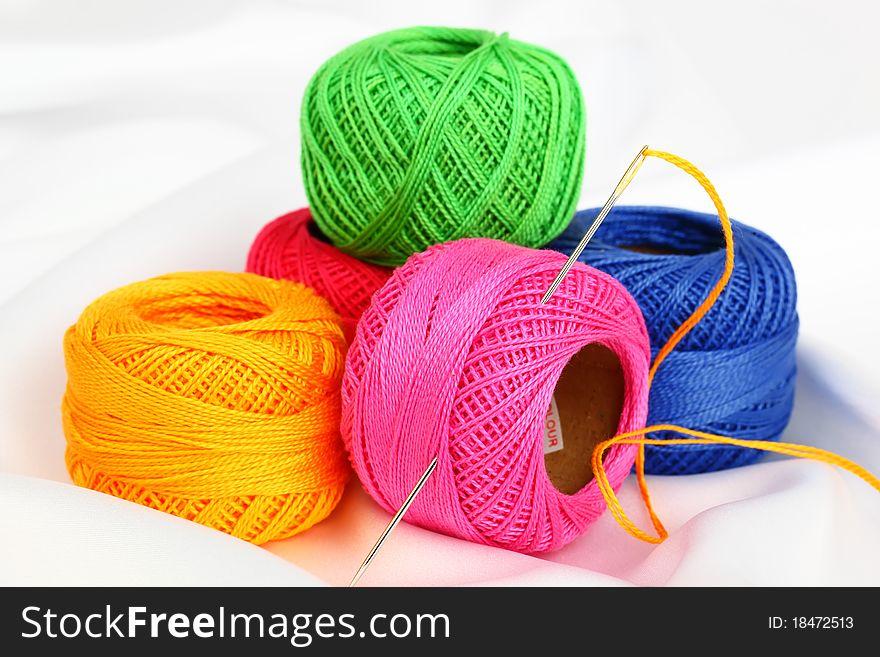 Colored thread, needles