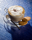 Free Cappuccino On Blue Glass Table Royalty Free Stock Image - 18488086