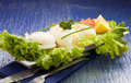 Free Squid With Lettuce On Blue Glasstable Stock Photo - 18489840