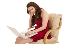 Free Woman Red Dress Sit Laptop Look Stock Photography - 18480002