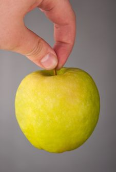 Free Green Apple In A Hand Royalty Free Stock Image - 18480406