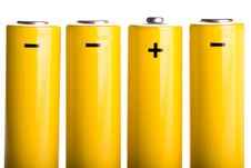Free Four Yellow Batteries Standing Stock Photo - 18480940